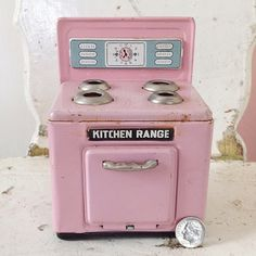 Everyday is a Holiday with this tiny pink kitchen range. Perfect for a doll house or decorative vignette.
