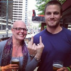 """Stephen Amell and his mother Instagram for their fight against cancer campaign """"giving the finger to cancer"""" :)"""