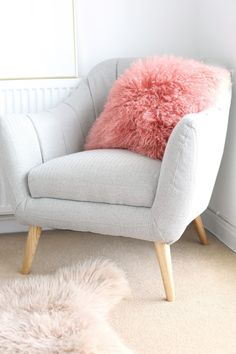 @hellooctoberathome Bedroom accent chair and fluffy pillow via hello-october.com
