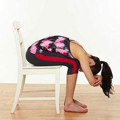 Chair Lower Back Stretch: 1. Sit in your chair and widen your legs so they are wider than hip distance apart.  2. From the hip crease, bend forward and allow your entire body to relax. Drop your head and completely relax your neck.  3. If you are not completely comfortable, try putting a rolled blanket or towel at the hip crease and lean over again.