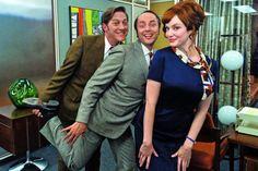 'Mad Men' stars Kevin Rahm, Vincent Kartheiser and Christina Hendricks pose as Elisabeth Moss takes a photo on set.