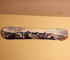Recycle that old snowboard and get creative.