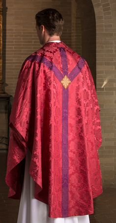 http://www.holyroodguild.com/xcart2/Passio-Domini.html  Early Baroque cut chasuble. A foundation of red Trevi damask. Saint Andrew's cross orphrey in Roman purple San Carlo damask, punctuated with an embroidered cross vesica.