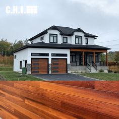 You shouldn't have to choose between curb appeal and practicality. Even up close, our Planks garage doors look as rich, authentic, and vibrant as natural wood. A dual layer of UV protection maximizes color retention, even in the harshest environments. Order your FREE Accents Woodtones color samples today! Shown: Planks in Cedar with optional black window frames. // via Alden's Shutters and Doors Faux Wood Garage Door, Modern Garage Doors, Best Garage Doors, Black Window Frames, Black Windows, Farmhouse Architecture, Modern Farmhouse Exterior, Carriage House Garage Doors, Planks