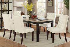 """7 pc Marleen collection dark brown finish wood marble top dining table set with white faux leather padded seats. This set includes the marble top table and 6 side chairs with padded seats. Table measures 38"""" x 64"""" x 30"""" H. Side chairs measure 21"""" x 26"""" x 39"""" H.  Some assembly required."""