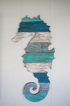 Wood Pallet Projects This is a seahorse made out of reclaimed pallet wood. You can have it as plain pallet wood, or hand painted by us to the colors of your Pallet Art, Diy Pallet Projects, Wood Projects, Pallet Ideas, Deco Marine, Wood Pallets, Pallet Wood, Painted Pallets, Pallet Walls