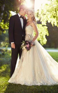 Gorgeous Lace on Moscato Lace on Tulle designer Wedding Dress from Essense of Australia gathers at the natural waist and then flows full into a romantic skirt and train. #Essense #WeddingDress