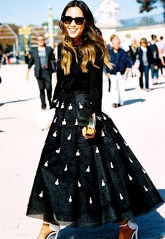 Aimee Song in a full black and white embellished skirt