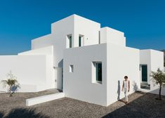 This bright white summer house on the Santorini coastline comprises a series of staggered blocks