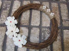 Jute wrapped, grape vine wreath with felt flowers.. $12.00, via Etsy.