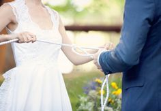 they tied a satin rope together during the wedding ceremony. Then the couple continues to tie a new knot for each year married.