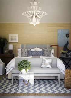 bedroom, chandelier , lighting, settee at foot of bed, lucite chest