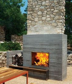 Interesting combination of rustic stone, concrete on this outdoor #fireplace. Dwell photo Brent Humphreys