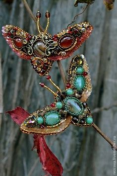 Agia Reztsova, Red and Green Butterfly Brooches. On her website there are so many beautiful bug and insect pieces. She is very talented.