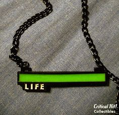 This necklace depicts a full health bar which is very familiar to gamers. This reminds me that I have my whole life head of me. I still have a full health bar, I'm in my prime. This gives me a purpose motivation. I can still do great things with my life whereas others may feel their best years are behind them.