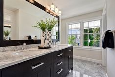 Transitional Master Bathroom with Flat panel cabinets, Undermount Sink, Complex marble counters, European Cabinets