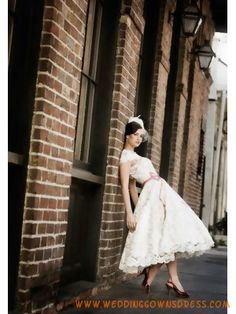 Sweet lace tea length wedding dress. Love the dancing capabilities in a dress like this.