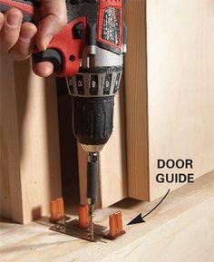 Wall door bottom guide