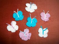 pinterest 365 day 344: crochet butterflies, these were one of my first attempts at crocheting by myself and the darn things were so cute, they just kept multiplying!  pattern freely available from little birdie secrets blog :)