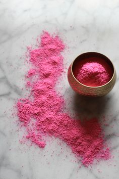 By now I'm sure you're getting a little sick of this pretty pink powder but it was a funnest Summer activity and makes for some really beautiful photos. I thought I'd share an easy DIY! I've always wanted to visit India, especially during the Holi festival in the Spring. There's something magical about the entire country turning into a sea of vibrant color. Since I'm so inspired by a wonderful wash of pigment I was pretty thrilled to try my hand at my own little batch. Here's what you'...