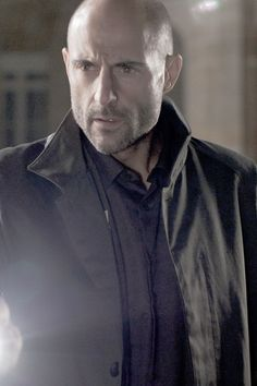 Actor Mark Strong looks somewhat how I imagine Nik to look. His features have an icy intensity of a lost soldier with a mind for mischief.