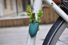 Have plant will travel. Keep it green on the go with this bike planter! #green #plants #cycling