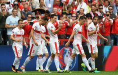 Fabian Schaer (C) of Switzerland celebrates scoring his team's first goal with his team matesduring the UEFA EURO 2016 Group A match between Albania and Switzerland at Stade Bollaert-Delelis on June 11, 2016 in Lens, France.