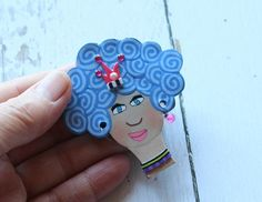 Funny magnet, woman magnet, face magnet, queen magnet, whimsical magnet, happy magnet, handmade magnet, gift for her, mothers day gift, grandmother gift, red magnet, pink magnet  Every woman is a queen!  This beautiful and funny magnet is made from polymer clay and is one of a kind piece. It is attached to a very strong magnet with strong glue, so it may serve its purpose for many years.  I make faces canes from polymer clay and in this work I use one slice of it, along with slices from spira...