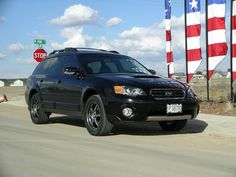 black subaru outback black rims