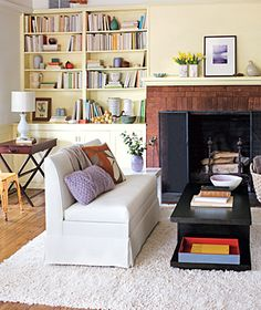 Arrange Your Shelves: Imagine living room shelves as display space for your favorite books, photographs, and family heirlooms.
