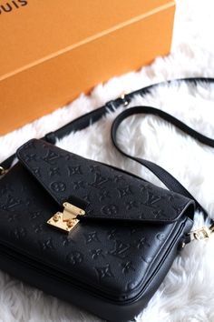 The Louis Vuitton Pochette Metis in black monogram empreinte leather with gold hardware - review and overview - luxury fashion blogger UK #luxurydesign