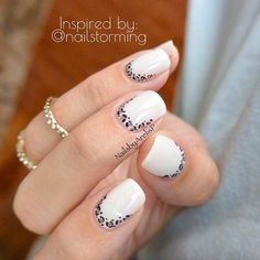 white and leopard ruffian manicure