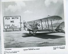 "Photo of a drawing taken from Disney's Victory through Air Power. This drawing represents the ""Fly-With-Me"" gypsy barnstormer period after WWI."