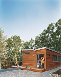 "A ""tree house"" of clean lines, ample glass, and thoughtful ingenuity lets a Washington, DC–area family and a stream of weekend guests enjoy prefab living in an unlikely locale: just outside Lost River, West Virginia."
