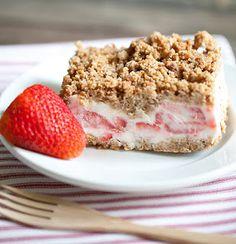 Frozen Strawberry Crunch Cake: Nature Valley granola bars, brown sugar, flour, butter, egg whites, sugar, heavy whipping cream, lemon, cream cheese, strawberries