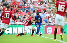 Riyad Mahrez of Leicester City in action with Luke Shaw of Manchester United during the FA Community Shield Match between Leicester City and...