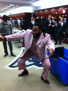 Brandon Spikes's lucky suit is all pink. Whatever it takes.