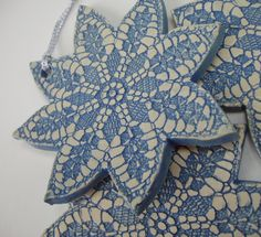 winter snowflake Christmas tree ornaments handcrafted pottery using antique lace doiley via Etsy.