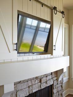 Fireplace Hidden TV. Hidden TV Fireplace Cabinet. Barn Door-style TV Cabinet to hide Tv above fireplace. #HiddenTV #TVCabinetaboveFireplace  Francesca Owings Interior Design.