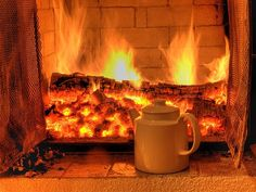every cosy cafe needs a glowing fire like this to sit & knit and read next to.