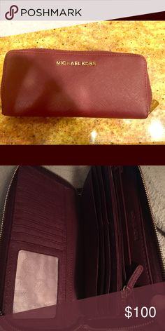 Michael Kira Wallett Michael Kids Wallet only used twice. In excellent condition. Color is burgundy Michael Kors Bags Wallets