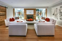 Furniture - Amazing White Big Sofas And Red Accent Pillows At Modern Living Room Also White Coffee Table On Wooden Floor With Fireplace Two Large Windows Opening: Amazing Big Sofas Design Ideas For Your Wide Rooms