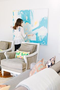 Have a big wall to cover? Just hang a large canvas and paint it as is (use oils to minimize possible drips & don't forget to turn on a fan for ventilation). Incorporate colors that coordinate with the interiors of the room, and you're done! -- Britt Bass' Northern Georgia Home Tour #theeverygirl