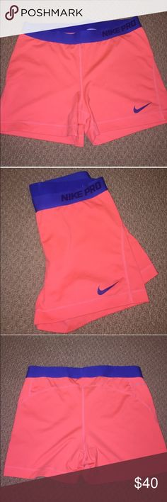NIKE PRO dri fit shorts NWOT NWOT Nike pro dri fit shorts. Royal band and Nike sign with a bright coral/salmon color short. Super cute and bright. Never been worn but tags were taken off thinking I was going to actually wear them. Size XL Nike Shorts