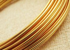 14 gauge non tarnish gold colored wire Gold Wire, Gauges, Wire Jewelry, Copper, Metal, Biscuit, Sign, Women, Handmade Bracelets