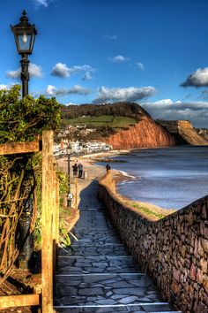 Viewpoint, Sidmouth, Devon England showing town and the red cliffs of the Jurassic Coast / Photofevor Images
