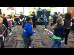 "Great!  Nutcracer March:  2nd Grade experienced the difference between an even marching rhythm and an uneven galloping rhythm. Here, Mrs. Creach's class demonstrates with candy cane ""horses"", bells, and egg shakers.  They also demonstrate rondo form (ABACABA) through their playing and movement."