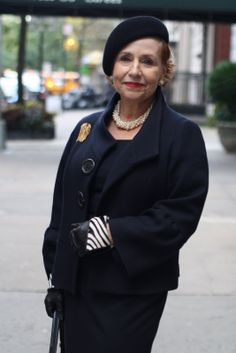 Another wonderful lady featured on the Advanced Style blog.  Like so many of the older women who pop up on that blog, she knows how to accessorize!