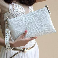 white Genuine cow Leather Clutch bag, Crocodile texture Rivet purse also in Metallic Gold, white Crocodile style genuine cow leather clutch with strap. Embellished with punk rivets in gold. Available in white or metallic Gold. Cute Handbags, Purses And Handbags, Cheap Handbags, Popular Handbags, Hobo Handbags, Handbags Online, Popular Purses, Hobo Purses, Prada Purses