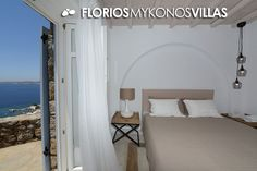 The spacious master bedrooms in the upper floor, are fully air conditioned with a unique minimal décor and elegant furniture. FMV1501 Villa for Rent on Mykonos island Greece. http://florios-mykonos-villas.com/property/fmv1501/